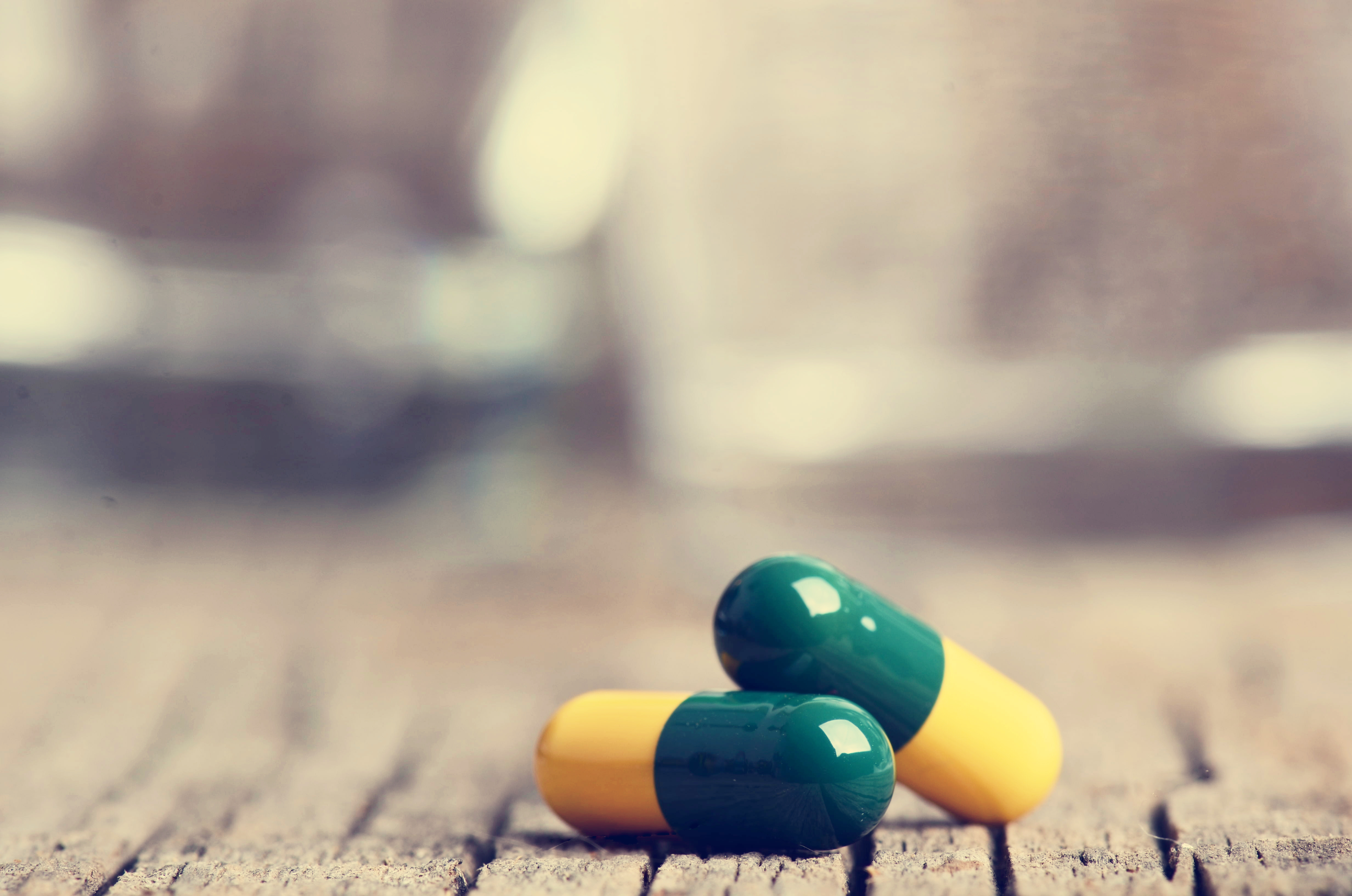 Pharmacy background. Pills on a wooden table. Medicine ...